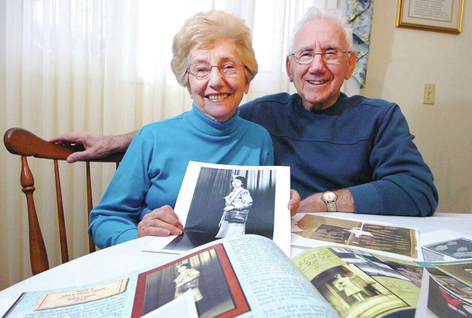 Hour Photo/ Alex von Kleydorff Judy and John Lippolis surrounded by keepsakes of her time in the Civil Air Patrol. / © 2012 The Hour Newspapers