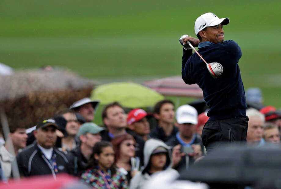 Tiger Woods hits his tee shot on the fourth hole of the north course at Torrey Pines during the second round of the Farmers Insurance Open golf tournament Friday, Jan. 25, 2013, in San Diego. (AP Photo/Gregory Bull) / AP