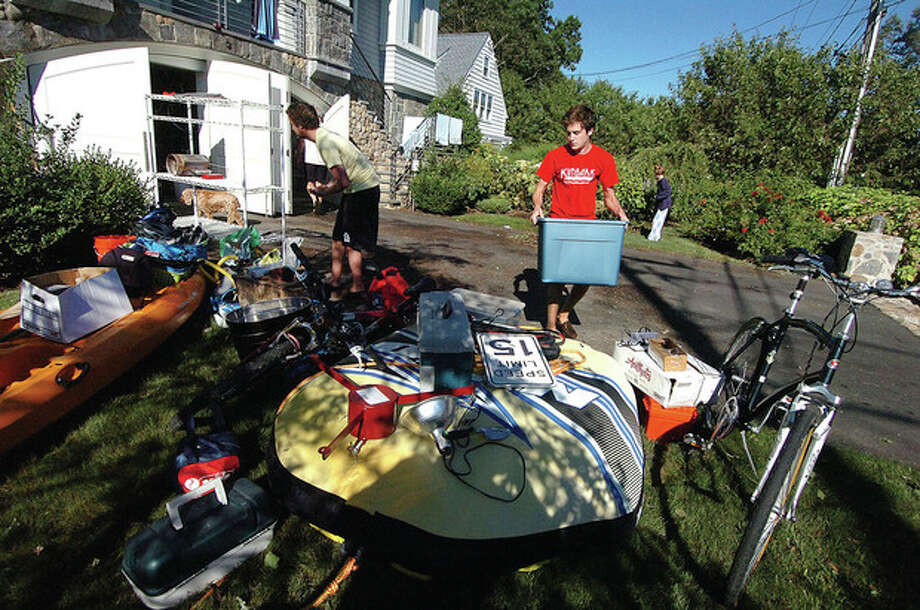 Hour photo / Alex von Kleydorff The Kelly family cleans up and dries out in Rowayton Monday morning in the aftermath of Tropical Storm Irene. / 2011 The Hour Newspapers