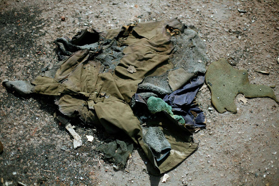 In this image taken during an official visit organized by the Malian army to the town of Konna, some 680 kilometers (430 miles) north of Mali's capital Bamako, Saturday, Jan. 26, 2013, a jacket lays on the ground of a destroyed base used by islamist rebels. One wing of Mali's Ansar Dine rebel group has split off to create its own movement, saying that they want to negotiate a solution to the crisis in Mali, in a declaration that indicates at least some of the members of the al-Qaida linked group are searching for a way out of the extremist movement in the wake of French air strikes. (AP Photo/Jerome Delay) / AP