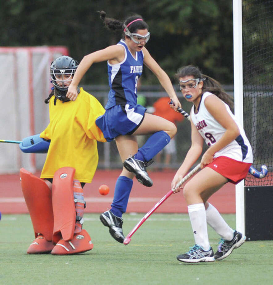 Hour photo/John Nash Brien McMahon's Samantha Bardos, right, waits on a ball as Fairfield Ludlowe's Melissa Warten tries to avoid getting hit. Ludlowe goalie Riley Thompson, left, looks on. Ludlowe scored a 2-1 victory, ending McMahon's bid for an FCIAC playoff berth.