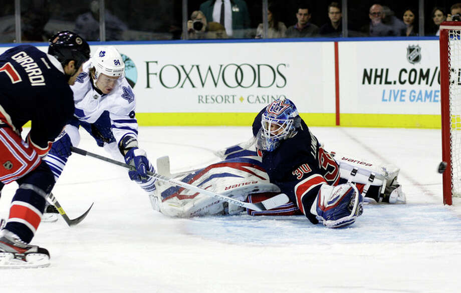 Toronto Maple Leafs' Mikhail Grabovski (84), of Germany, shoots the puck past New York Rangers goalie Henrik Lundqvist, of Sweden, during the first period of an NHL hockey game, Saturday, Jan. 26, 2013, in New York. (AP Photo/Frank Franklin II) / AP