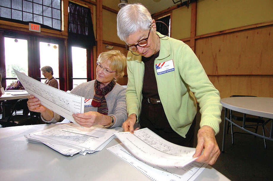 File Photo/ Alex von Kleydorff. From left, Cindy Warde and Judy Zucker check ballots during a past election audit in Wilton / 2011 The Hour Newspapers