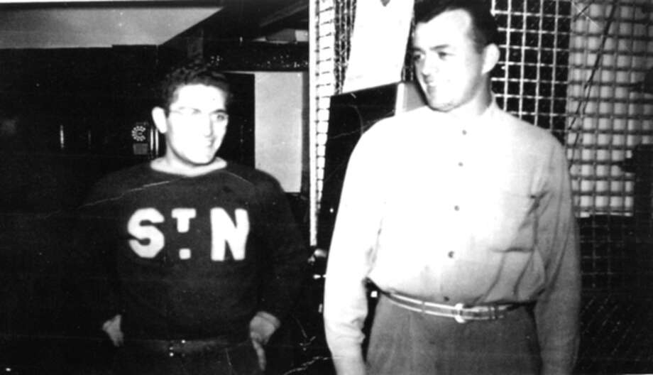 Contributed photo Leo Skidd, right, owner of the Crystal Rink, talks with fellow Norwalker Pete Correnty at the rink in 1949. Correnty began working at the rink when he was in junior high school and years later formed the Home Oil Hockey Club, one of the top U.S. semipro teams which played its home games at Crystal Rink.