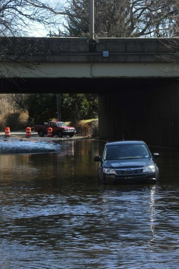 A car on Keeler Avenue in Norwalk is stranded due to flooding. hour photo/matthew vinci