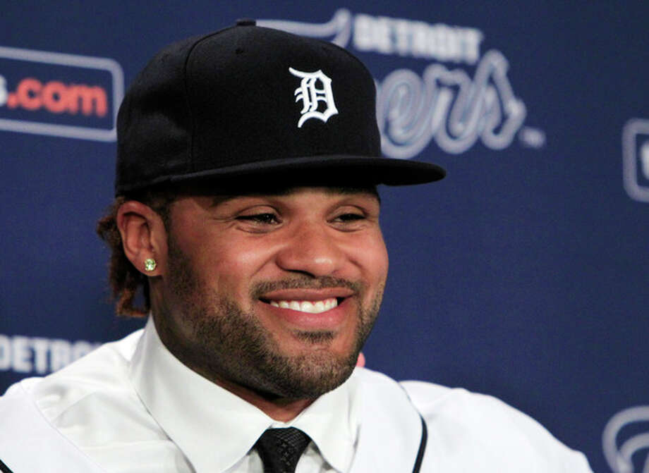 ADVANCE FOR WEEKEND EDITIONS, FEB. 11-12 - FILE - In this Jan. 26, 2012, file photo, Prince Fielder is introduced to the media after agreeing to a $214 million, nine-year contract with the Detroit Tigers during a baseball news conference at Comerica Park in Detroit. The 14 AL teams have spent $776.8 million on major league contracts for players who became free agents after the World Series and the NL's 16 clubs have committed $597.3 million. (AP Photo/Carlos Osorio, File) / AP2012
