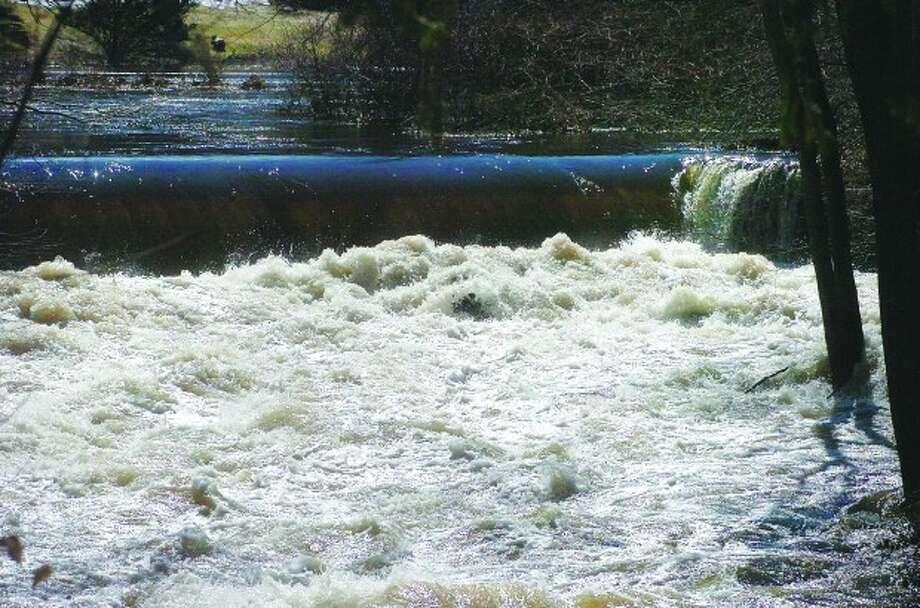 Photo/Alex von Kleydorff. The Silvermine River rushes towards the James St bridge in Norwalk Monday.