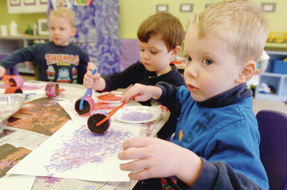 2 year olds in Wilton Parks and Recs' On School Road program, Tommy Lussier, Roberto Davison and Luke Lussier , create art projects as part of preschool's daily activities. Hour photo / Erik Trautmann / (C)2011, The Hour Newspapers, all rights reserved