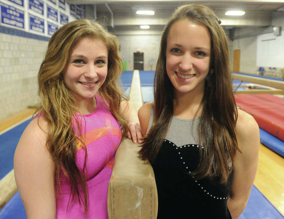 Hour photo/John Nash - Wilton High senior gymnastic co-captains Chelsea LeVander, left, and Haley Shaughnessy lead the Warriors this season.