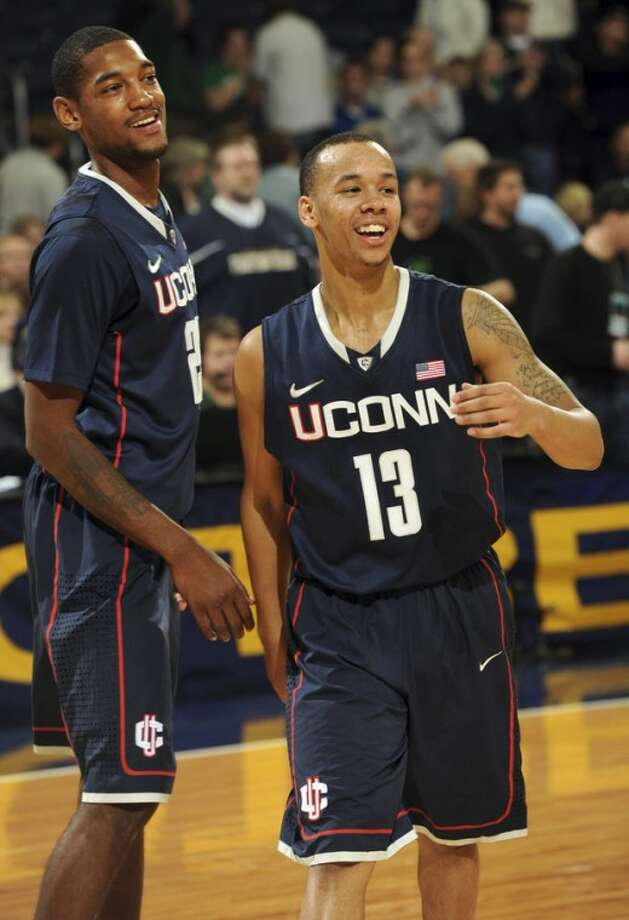 Connecticut forward Roscoe Smith, left, and guard Shabazz Napier celebrate their 67-53 victory over Notre Dame in an NCAA college basketball game, Saturday, Jan. 14, 2012, in South Bend, Ind. (AP Photo/Joe Raymond)