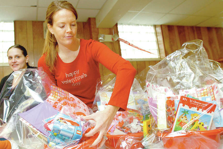 Theresa Zagarino organizer of the No Drama Mammas & Pappas of Fairfield Countyand Amy Gardener create 35 to 40 Valentine's 'Craft Baskets' at the East Norwalk Library Saturday for the patients at Yale's Pediatric Oncology Unit in New Haven. Hour photo / Erik Trautmann / (C)2011, The Hour Newspapers, all rights reserved