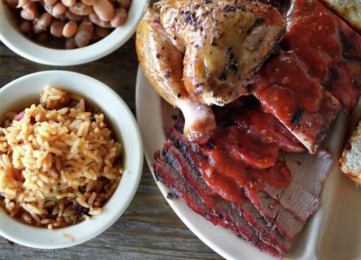 Chicken, Pork Ribs, Beef Brisket, Jambalaya Texana, Jalapeé±o Pinto Beans, Original Barbeque Sauce from Goode Co. Barbecue restaurant.