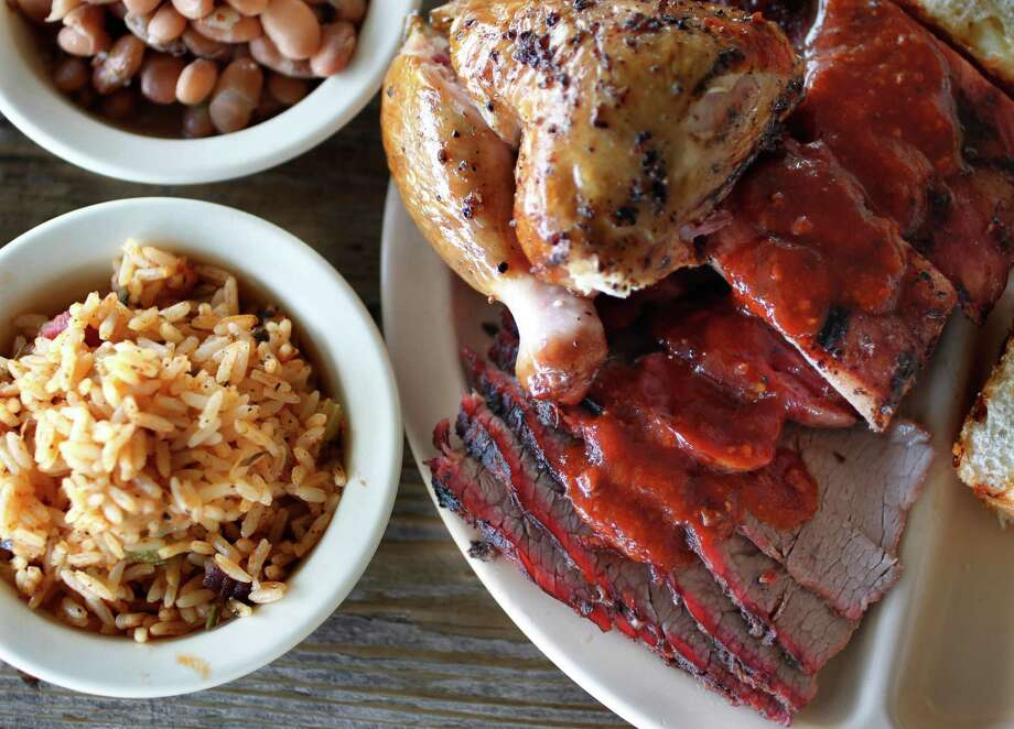 Chicken, Pork Ribs, Beef Brisket, Jambalaya Texana, Jalapeé±o Pinto Beans, Original Barbeque Sauce from Goode Co. Barbecue restaurant. Photo: Mayra Beltran, Staff / © 2012 Houston Chronicle