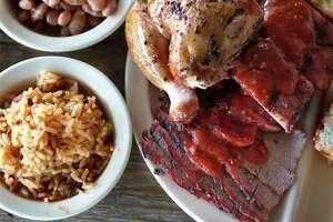 Chicken, Pork Ribs, Beef Brisket, Jambalaya Texana, Jalapeé±o Pinto Beans, Original Barbeque Sauce from Goode Co. Barbecue restaurant.
