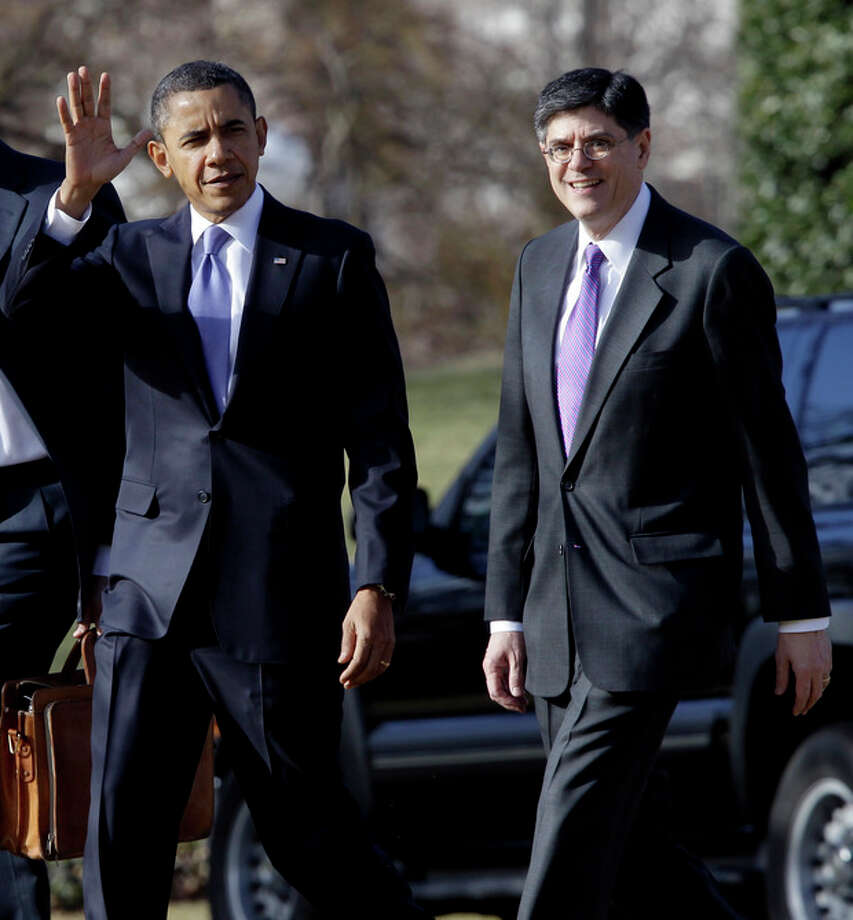 FILE - In this Feb. 14, 2011 file photo, President Barack Obama walks with Budget Director Jack Lew on the South Lawn of the White House in Washington. Two senior administration officials say the White House chief of staff, William Daley, is resigning. He's being replaced by Jacob Lew. (AP Photo/Charles Dharapak, File) / AP