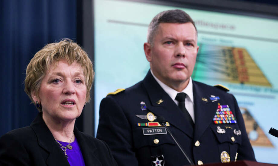 Deputy Defense Undersecretary for Military Personnel Policy Vee Penrod, left, and Principal Director for Military Personnel Policy Maj. Gen. Gary Patton, take part in a news conference at the Pentagon, Thursday, Feb. 9, 2012, to discuss the results of the department's Women in Service Review. (AP Photo Manuel Balce Ceneta) / AP