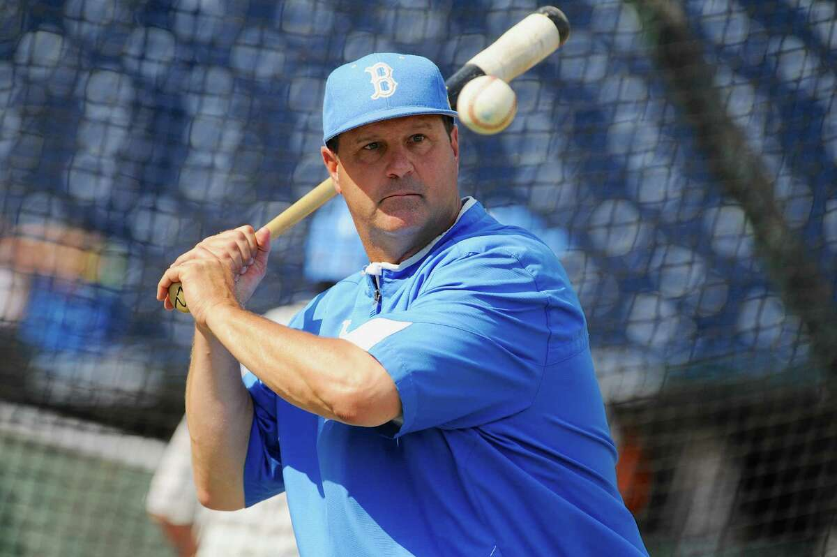 UCLA coach John Savage eyes the ball during NCAA college baseball practice at TD Ameritrade Park in Omaha, Neb., on June 14, 2013.