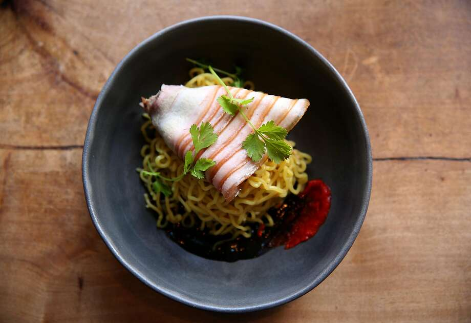 Dennis Lee, Namu Gaji: Thinly sliced soy cured smoked belly layered with blanched napa cabbage on a bed of golden noodles. Photo: Photo Credit (all Restaurant Dishes Except Namu Gaji + Cafe Asia) Alanna Hale.�Photo Credit (Namu Gaji + Cafe Asia Only): Zejian Shen.�Meat-Shaped Stone Photo Caption:�Meat-shaped Stone, Approx. 1800�1900. China, Qing Dynasty (1644�1911).