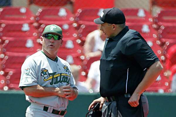Tulane head coach David Pierce discusses a call with home plate umpire Mark Uyl during the third inning of a game at Schroeder Park on May 20, 2016, in Houston.