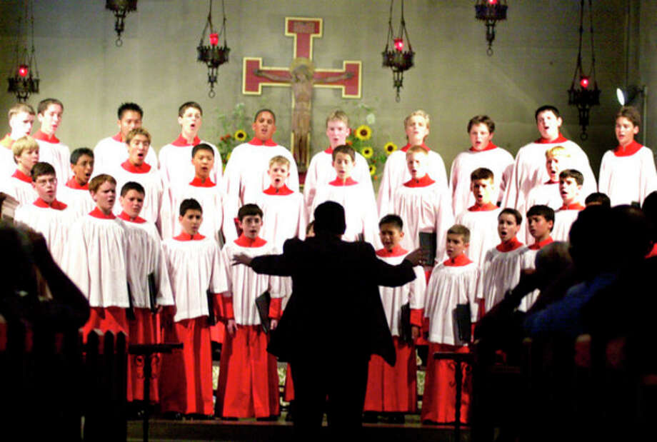 Music Director, Joseph Crnko conducts the Northwest Boychoir at St.Paul's church on Tuesday night..photo matthew vinci