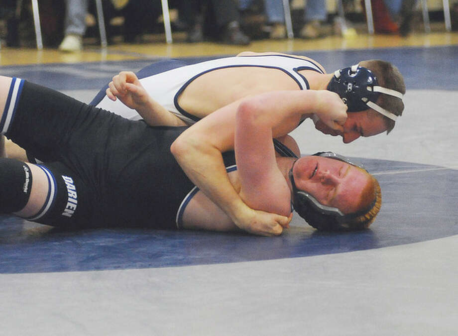 Wilton's Wyat Cobb wins over Darien's Tyler Hill 152 weight class. hour photo/Matthew Vinci / (C)2011, The Hour Newspapers, all rights reserved