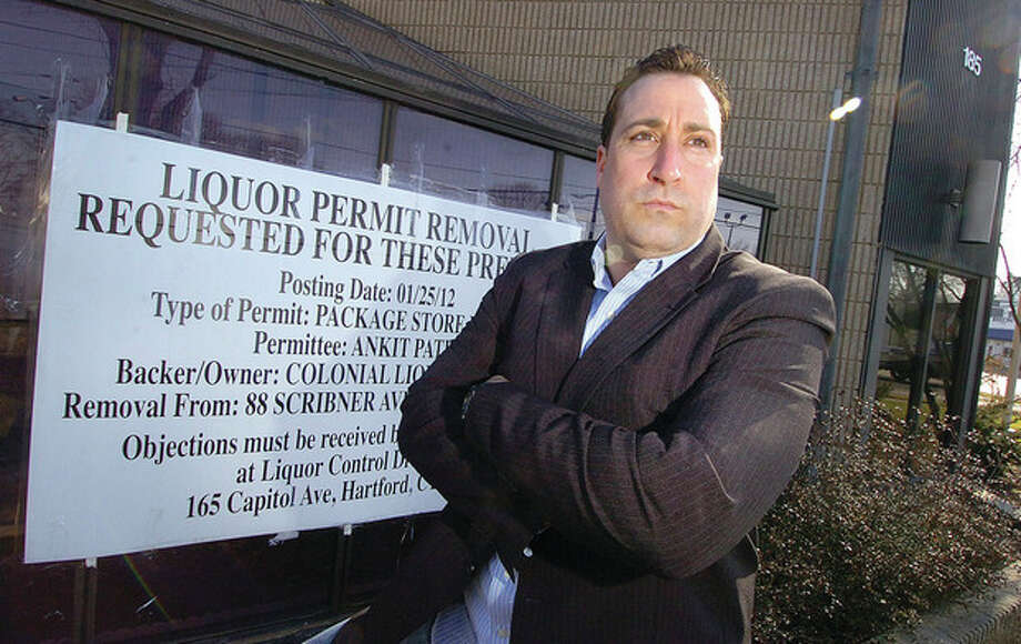 Hour photo / Alex von Kleydorff Olmstead Place resident Michael Vaccaro stands in front of 185 East Ave., located at the end of Olmstead Place. He is among neighbors in the area opposed to a new liquor store at this address. / © 2012 The Hour Newspapers