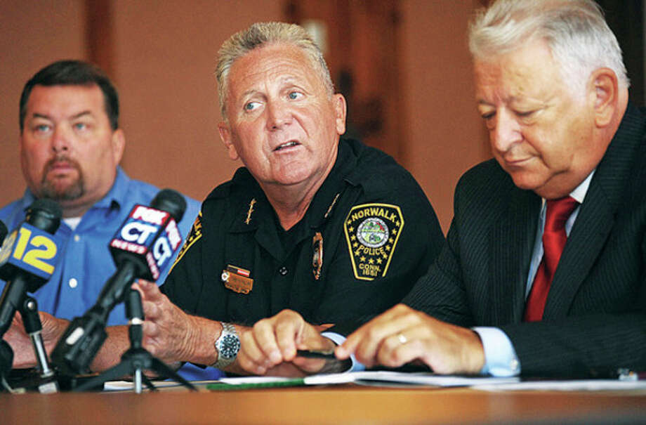 Norwalk Police Chief Harry Rilling, Lt. William Lowe and Mayor Richard Moccia hold a press conference at City Hall Thursday morning to comment on the recent gang related arrests and the other murder invertigations. Hour phoot / Erik Trautmann / (C)2010 The Hour