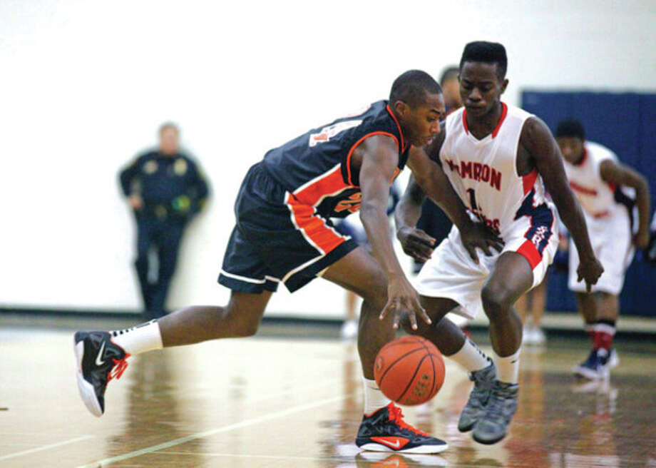 Kenny Wright, #24 from Stamford, dribbles the ball during a game against Brien McMahon in Norwalk Tuesday evening. Hour Photo / Danielle Robinson
