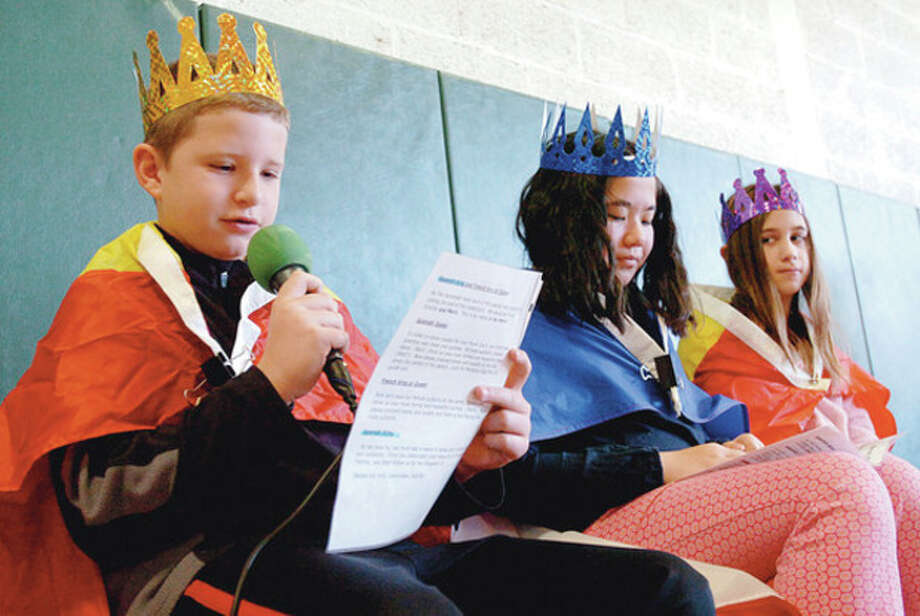 5th grade royalty Richard Nolan, Leah Moore and Anna Travers read a proclamation after their coronation during the language department's Three Kings Day at Cider Mill Elementary School Friday. Hour photo / Erik Trautmann / (C)2011, The Hour Newspapers, all rights reserved