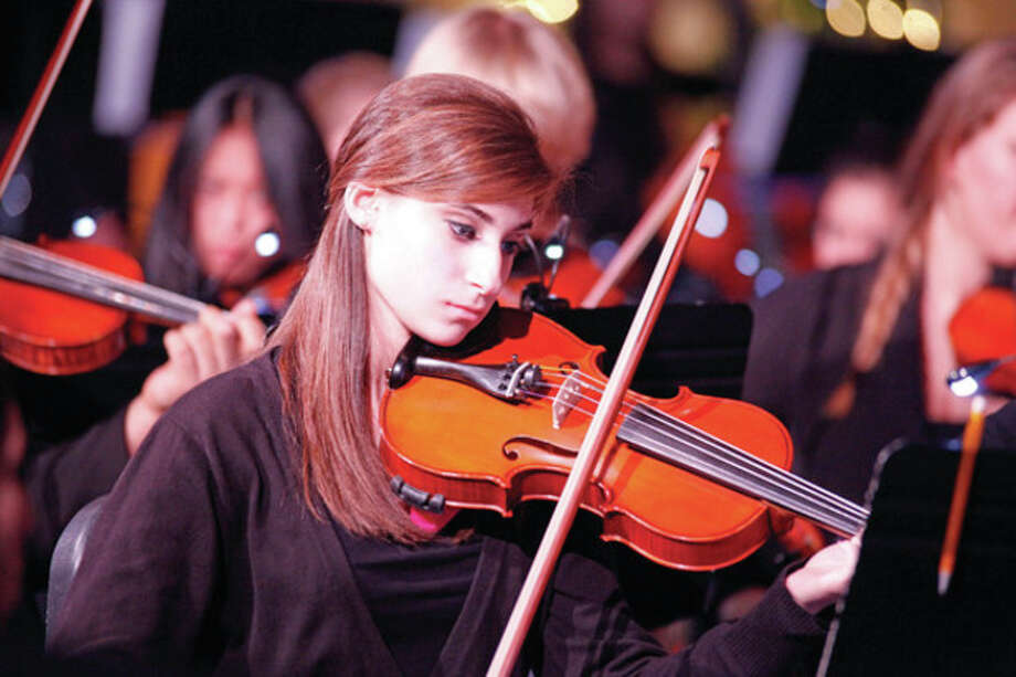 A Norwalk High student performs in the annual Candlelight concert Wednesday evening. Hour Photo / Danielle Robinson