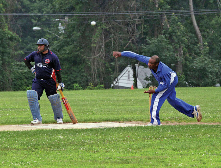 Everton McHarge, a bowler for the Norwalk Cricket Club, pitches to a batter during a recent game of cricket against West Haven, held at Ponus Ridge Middle School in Norwalk. Hour Photo / Danielle Robinson