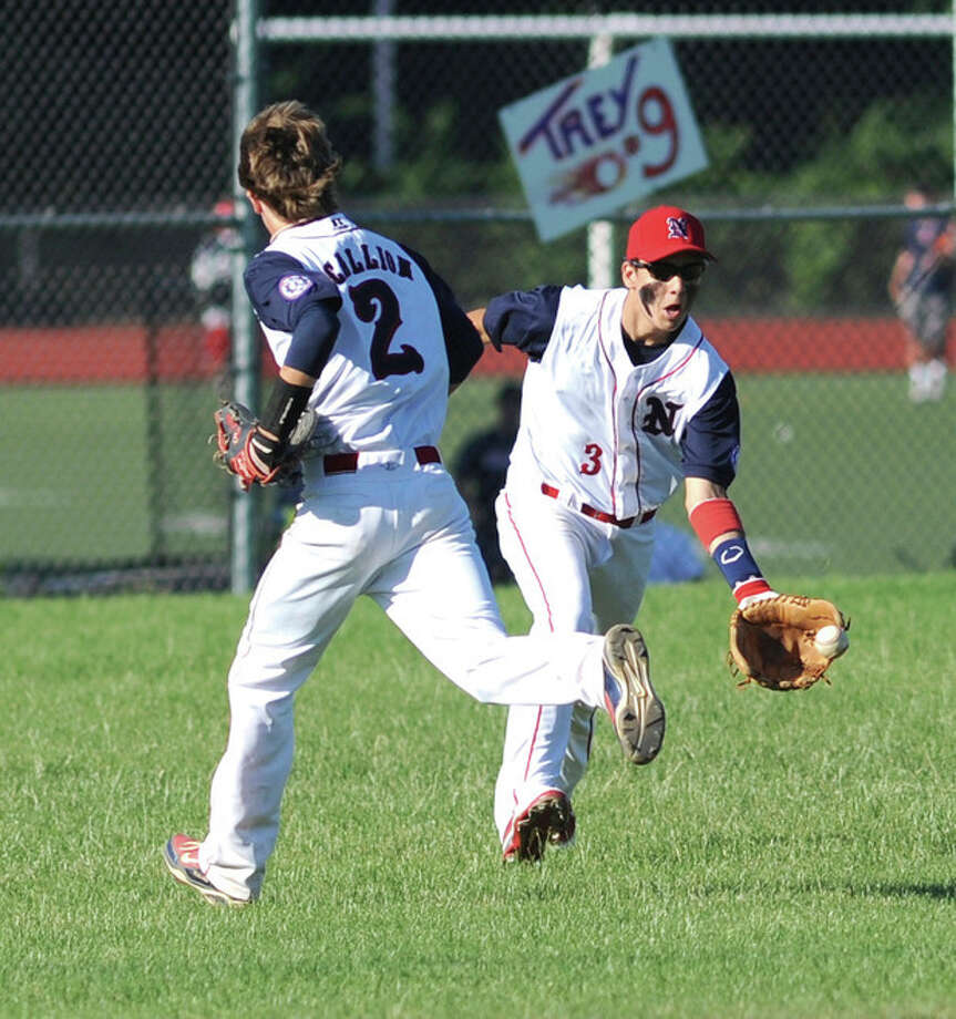 Hour Photo/John Nash Norwalk center fielder Ed Petrillo, right, collects the ball on a bounce after a Texas League single fell in between him and shortstop Alex Scallion during TuesdayÕs Babe Ruth game at Brien McMahon.