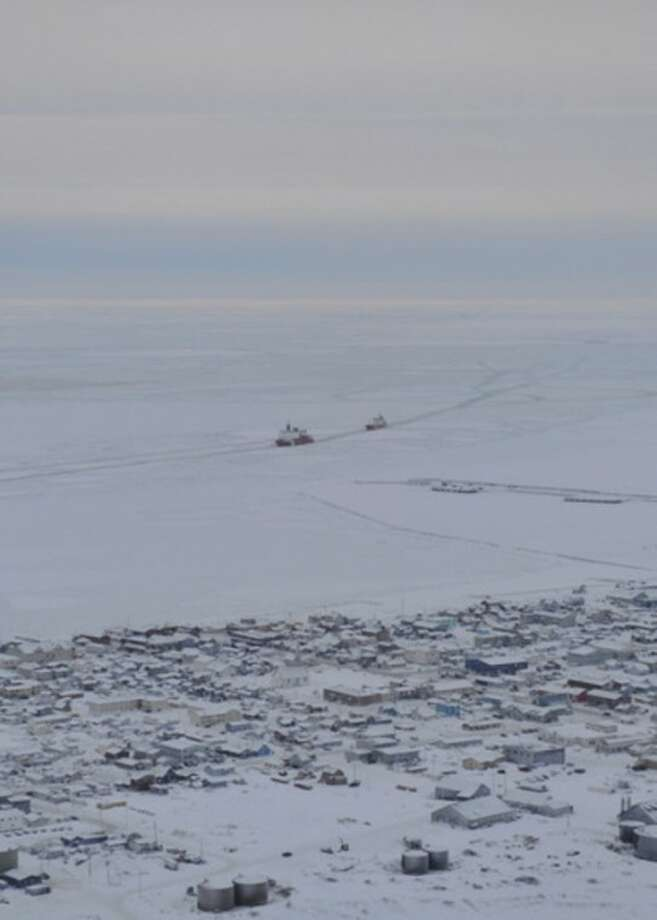 In this image provided by the U.S. Coast Guard the Coast Guard Ice Breaker Healy guides the Russian tanker Renda closer to the fuel transfer mooring point Saturday Jan. 14, 2012. Russian tanker carrying much-needed fuel to Nome moored less than a half mile from the town's iced-in harbor Saturday evening, starting final preparations for delivering the diesel fuel and gasoline, the Coast Guard said. (AP Photo/US Coast Guard, Petty Officer 2nd Class Charly Hengen)
