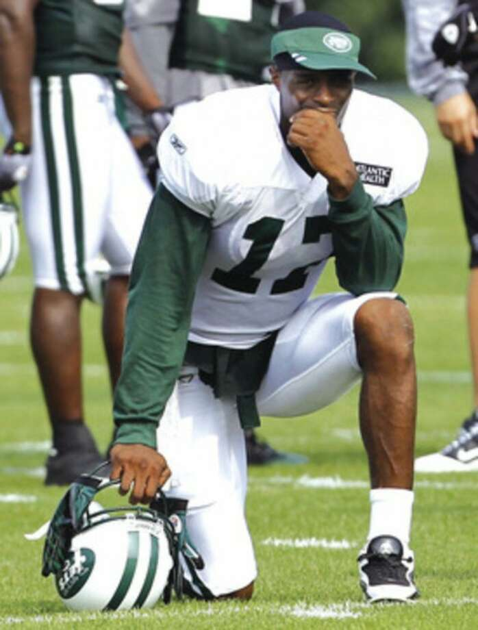 @White=[C] AP photo New York Jets wide receiver Plaxico Burress looks on during a training camp earlier this week. On Friday, the Jets said the wide receiver would not play in the team's preseason opener due to an ankle injury.