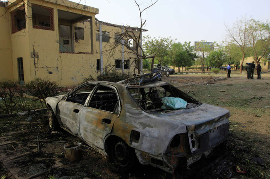 The wreckage of a suicide bombing is seen at police headquarters in Kano,Nigeria. Sunday, Jan. 22, 2012. More than 150 people were killed in a series of coordinated attacks by a radical Islamist sect in north Nigeria's largest city, according to an internal Red Cross document seen Sunday by an Associated Press reporter..(AP Photo/Sunday Alamba) / AP
