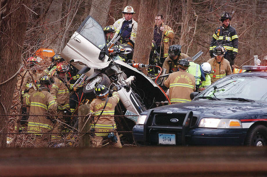 Hour Photo/ Alex von Kleydorff. Merritt Parkway northbound accident in Stamford Thursday morning. / 2011 The Hour Newspapers