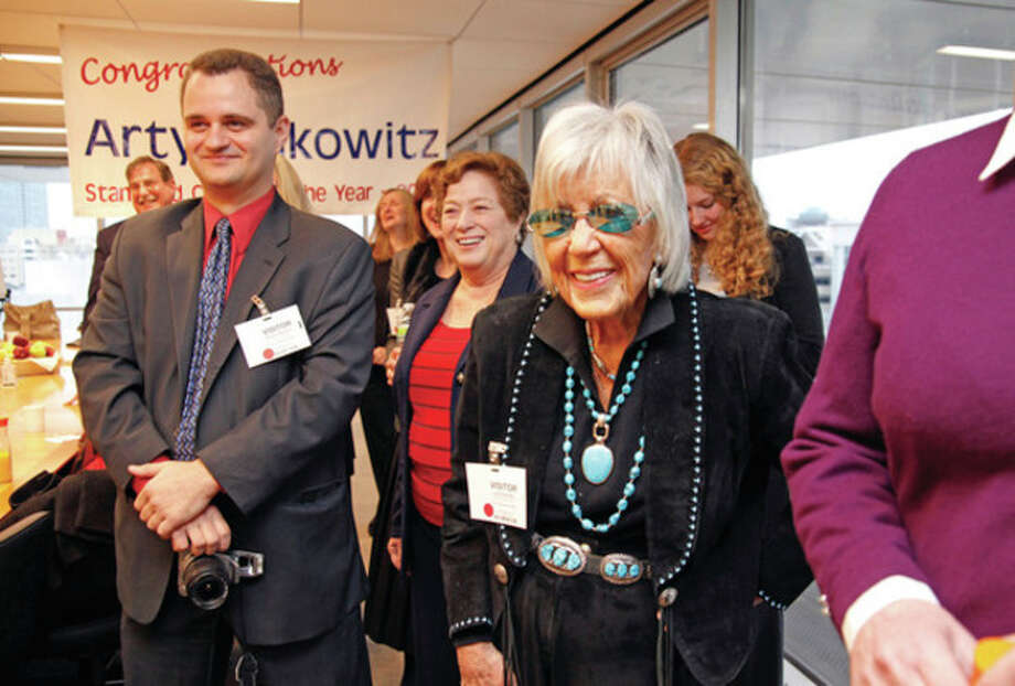 Arty Selkowitz is suprised by an ambush of friends, family and co-workers who came out to see him be honored as the 2011 City of Stamford Citizen of the Year at Perdue Pharma in Stamford Thursday morning. Hour Photo / Danielle Robinson