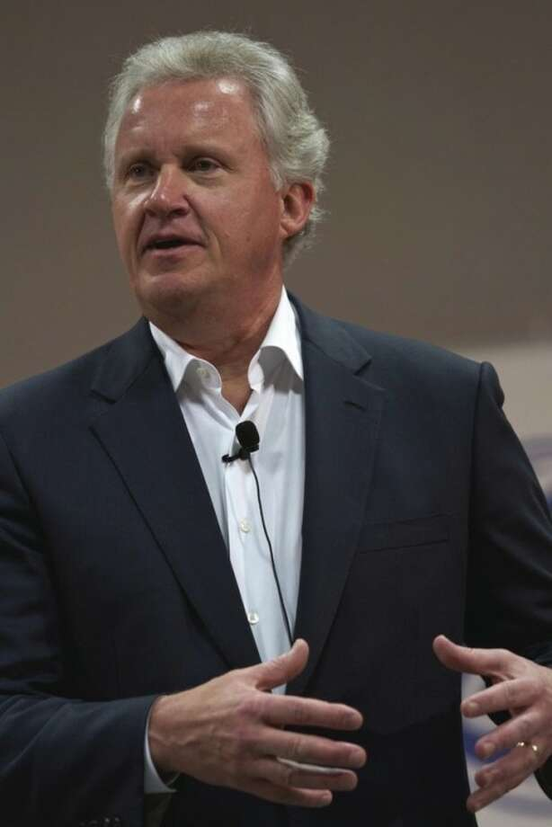 In this June 13, 2011 photo, General Electric CEO Jeff Immelt, speaks to employees, during a town hall meeting at the GE Energy Greenville Operations campus in Greenville, S.C. General Electric Co. says earnings grew 21 percent in the second quarter as its lending arm continued to recover from the recession. General Electric Co. said Friday, July 22, 2011, earnings grew 21 percent in the second quarter as its lending arm continued to recover from the recession.(AP Photo/Brett Flashnick)
