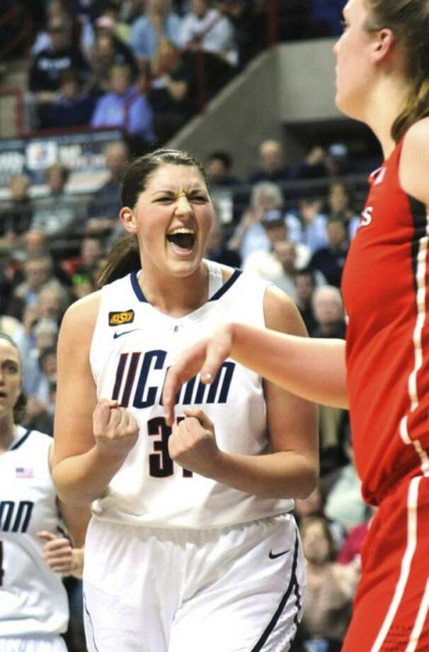 Connecticut's Stefanie Dolson celebrates after her team scored a basket in the first half of an NCAA college basketball game at Storrs, Conn., Saturday, Feb. 4, 2012. (AP Photo/Bob Child)