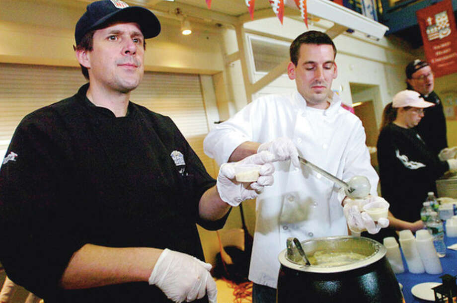 Brad Pape and Jade Fischer of the Old Post Tavern serve up clam chowder during the Westport's Chowdafest Saturday that benefits the Connecticut Food Bank. Hour photo / Erik Trautmann / (C)2011, The Hour Newspapers, all rights reserved