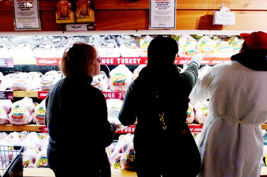 Hour file photo - Shoppers pick out a turkey at Stew Leonard''s.