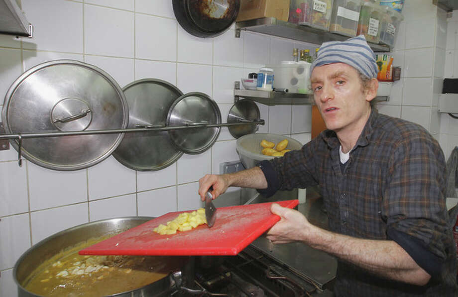 AP Photo/Jacques Brinon In this Friday, Oct. 28, 2011 photo, American chef Marc Grossman cooks in his restaurant Bob's Kitchen, in Paris. French chefs have been opening fine restaurants stateside for eons, but up until about a decade ago, the opposite would have been almost unthinkable. / AP