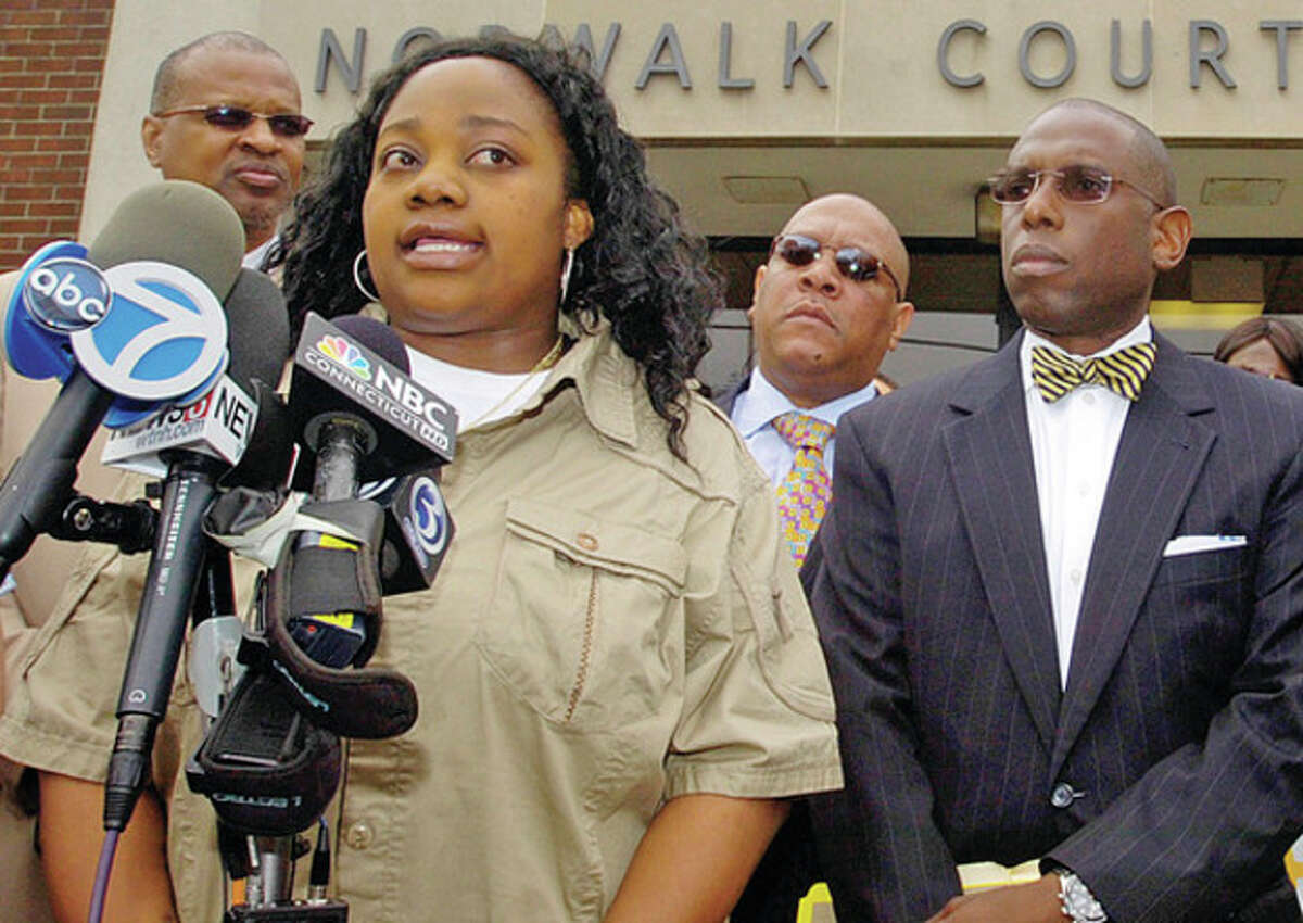 Tanya McDowell,who was charged with fraud after she allegedly enrolled her son the Norwalk Public Schools, comments during a press conference outside Norwalk Superior Court Wednesday morning. Hour photo / Erik Trautmann