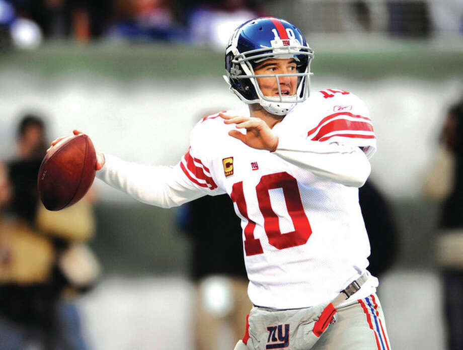 AP photo Eli Manning looks to pass during a December game. With a running game that is last in the league, the New York Giants' offense will rely on Manning's arm in their playoff game Sunday against the Atlanta Falcons. / AP2011