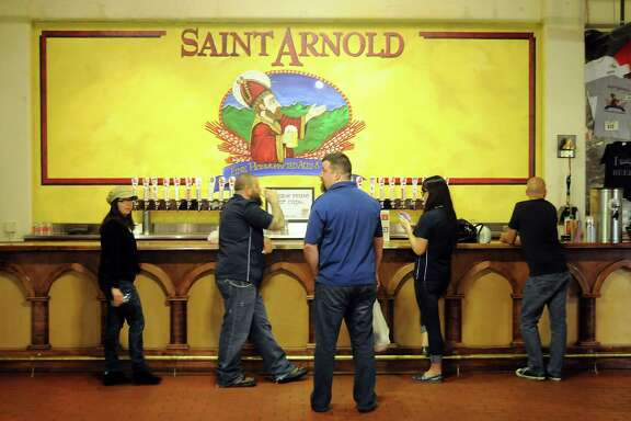 Guests sample the varieties at the St. Arnold Brewery Tuesday April 2, 2013.(Dave Rossman photo)