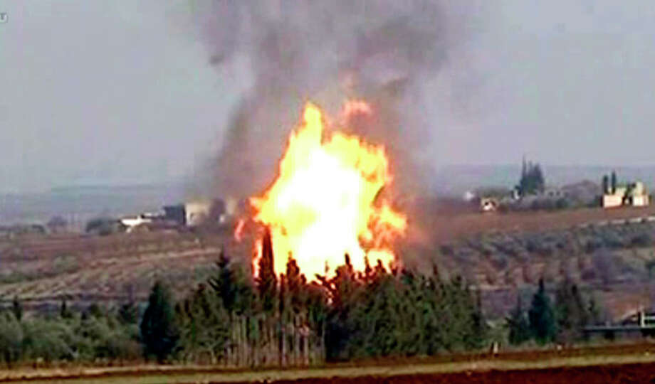 In this photo released by the Syrian official news agency SANA and according to them, flames raise from a gas pipeline caused by an explosion attack, near the town Rastan in the restive Homs province, Syria, on Tuesday Jan. 3, 2012. An explosion struck a gas pipeline in central Syria in an attack the government blamed on terrorists, the state-run news agency said. There were no casualties. The pipeline feeds two power stations. French President Nicolas Sarkozy says the Syrian regime is committing massacres and he is calling on President Bashar Assad to leave power. (AP Photo/SANA) EDITORIAL USE ONLY / SANA
