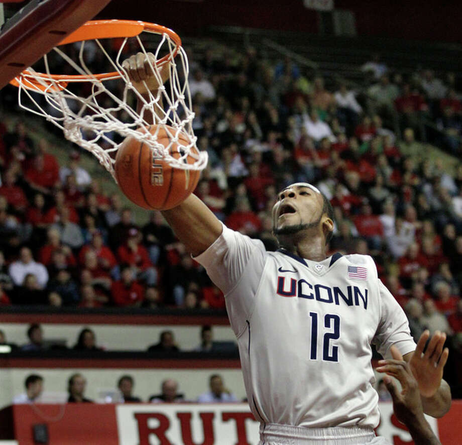Connecticut's Andre Drummond (12) dunks during the first half of an NCAA college basketball game against Rutgers in Piscataway, N.J., Saturday, Jan. 7, 2012. (AP Photo/Mel Evans) / AP