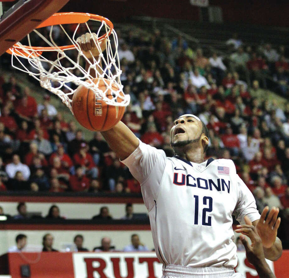 AP photo UConn's Andre Drummond dunks during Saturday night's game against Rutgers. The Knights scored a 67-60 victory. / AP