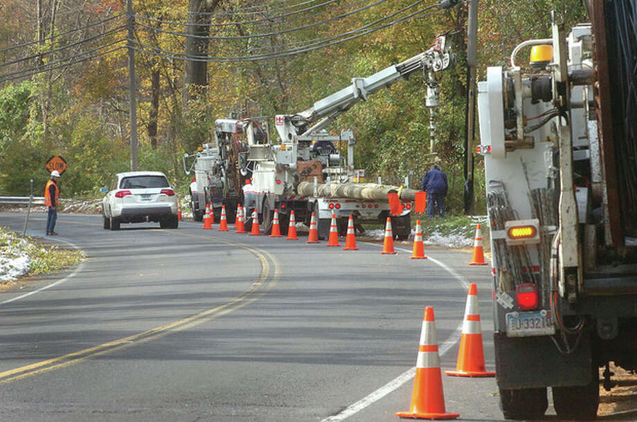 Hour Photo/ Alex von Kleydorff. Crews work to replace a utility pole just south of Bayberry La. on New Canaan rd Wilton on Teusday afternoon. / 2011 The Hour Newspapers