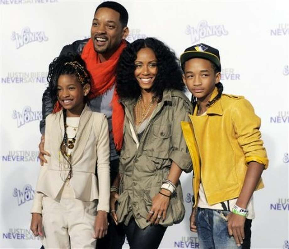 "Will Smith, top left, and his wife Jada Pinkett Smith pose with their daughter Willow, left, and son Jaden at the premiere of the documentary film ""Justin Bieber: Never Say Never,"" in Los Angeles, Tuesday, Feb. 8, 2011. Jaden Smith is featured in the film. (AP Photo/Chris Pizzello)"